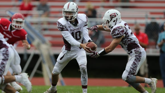 Scarsdale quarterback Michael Callahan, 10, hands off