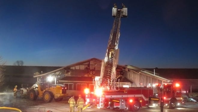 Firefighters from 13 departments assisted the Johnson Creek Fire Department as they fought a blaze at Dettmann Dairy in the town of Milford on Jan. 13. Sub zero temperatures caused problems with icing.