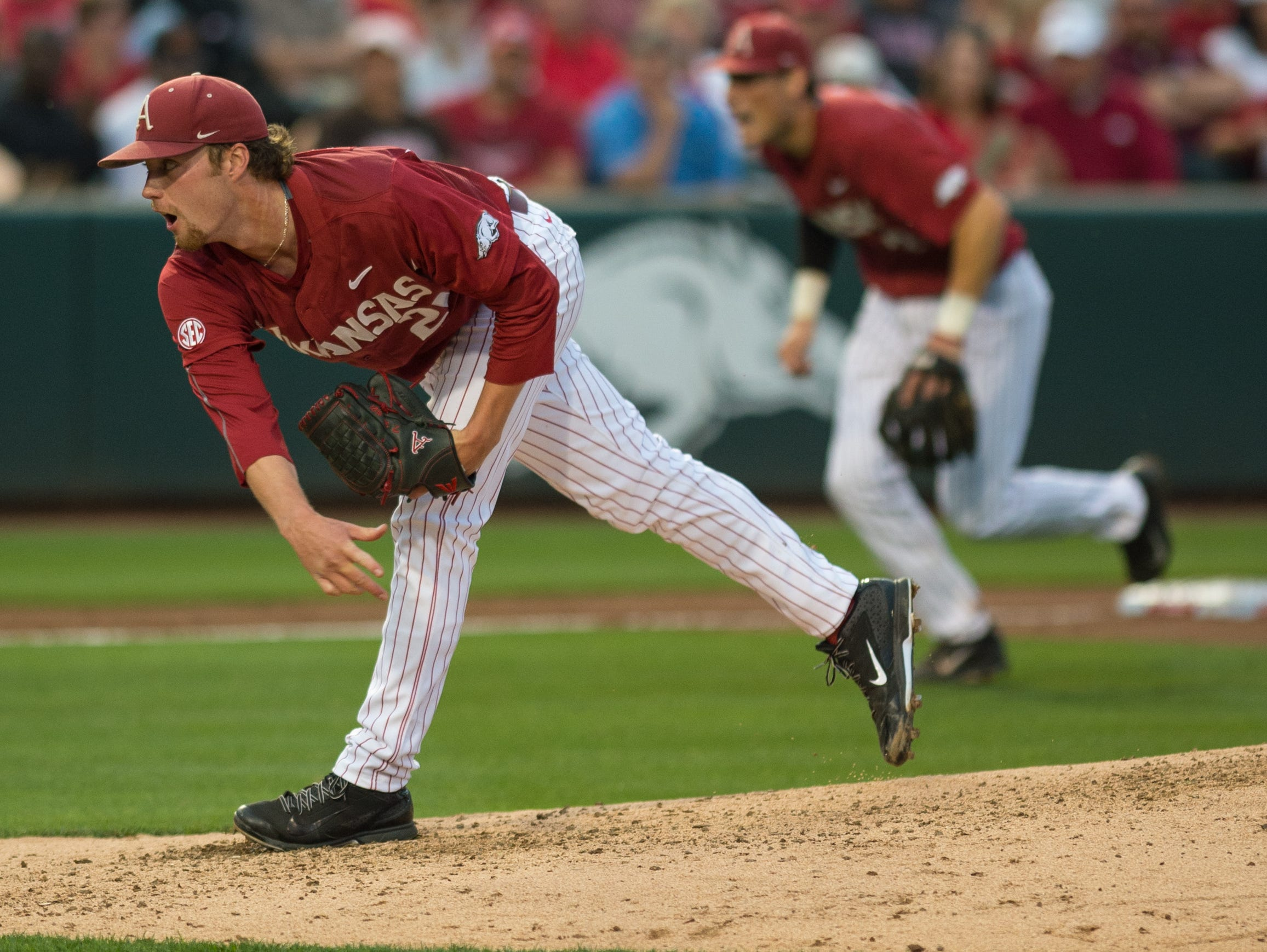 Arkansas' Trey Killian follows through on a pitch during Friday night's 5-4 loss to Tennessee at Baum Stadium in Fayetteville.
