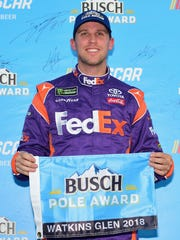 Denny Hamlin poses for a photo after winning the Pole Award during qualifying for the Monster Energy NASCAR Cup Series Go Bowling at The Glen at Watkins Glen International on Aug. 4.