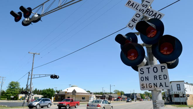 Rail crossings in Charlotte were closed for a time on Tuesday after a train struck a pedestrian.