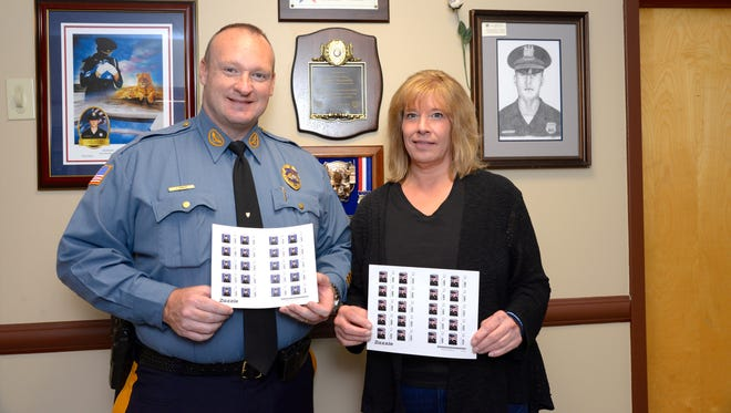 Cliffside Park Police Department's Juvenile Bureau selling stamps memorializing fallen officer Stephen Petruzzello, who was struck and killed by an SUV in 2014, to benefit the junior police academy. Stephen Petruzzello's mom Linda Petruzzello and police officer Jason Kangas(who runs the academy) are hold the stamps in CPPD.