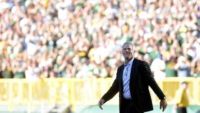 Brett Favre gazes into a sold out crowd in the bowl of Lambeau Field, where he would have his number retired and be inducted into the Green Bay Packers Hall of Fame,  in Green Bay, Wis. on Saturday, July 18, 2015. Kyle Bursaw/Press-Gazette Media/@kbursaw