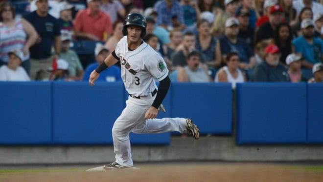 Norfolk Tides Mike Yastrzemski looks for the ball as he rounds third base during the Tides game with the Scranton/Wilkes-Barre Railriders on Friday, May 27, 2016 in Norfolk, Va. Yastrzemski spent time with the Delmarva Shorebirds before moving up to the Orioles AAA Norfolk team.