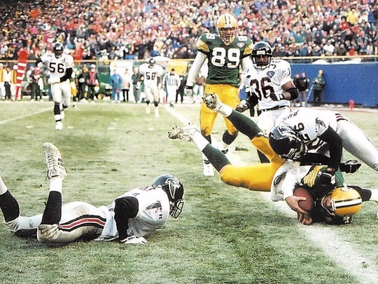 With 21 seconds left, the ball at the 9-yard line and trailing 17-14, Green Bay Packers quarterback Brett Favre gambled and ran the ball in the end zone to beat the Atlanta Falcons on Dec. 18, 1994, in the final game played at Milwaukee County Stadium.