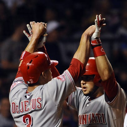 Eugenio Suarez (7) high-fives Ivan De Jesus (3) after they both scored on his two-run homer in the sixth inning.