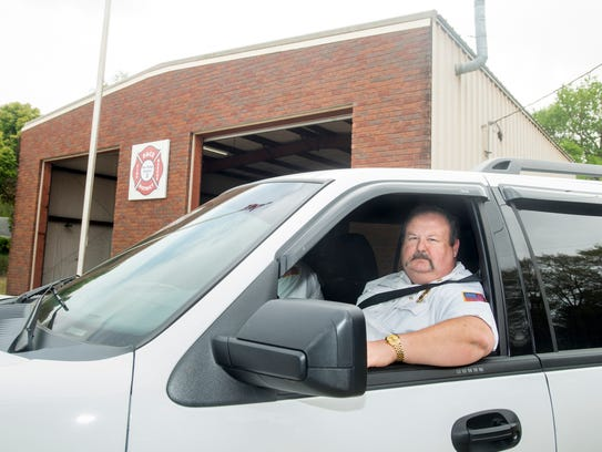 Chief Robbie Whitfield sits in front of the Pace Fire
