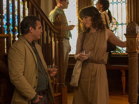 """Joaquin Phoenix and Parker Posey in a scene from """"Irrational Man."""""""