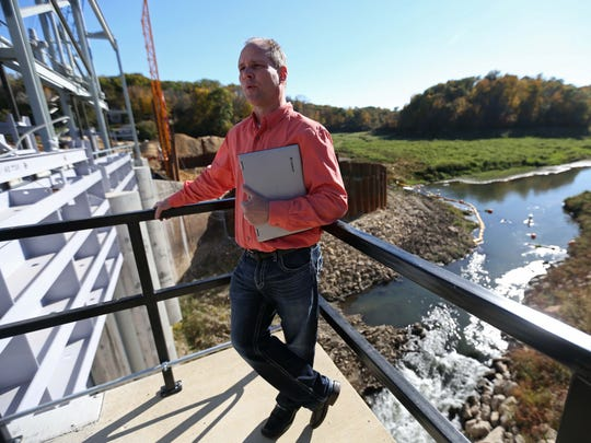 Steve Leonard, President of the Lake Delhi Board of Trustees stands on the top of the Lake Delhi dam on October 9, 2015, in rural Delaware County. After six year, the lake is going to be refilled this summer.