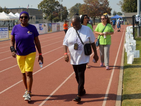Tulare Relay For Life participants walk during the