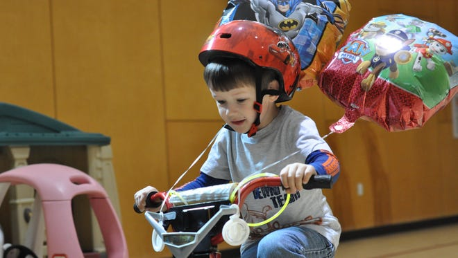 Andrew Taylor, 5, rides in the Trike-A-Thon for St. Jude Friday.