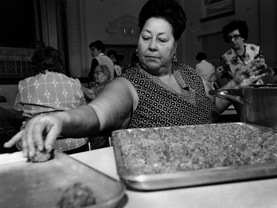 Jan. 17, 1976: Louise Bonomini, with deft touches, keeps the meatball production line going as feast-time nears at Sacred Heart Church. Photo credit: Danny Daniels scanned April 8, 2011