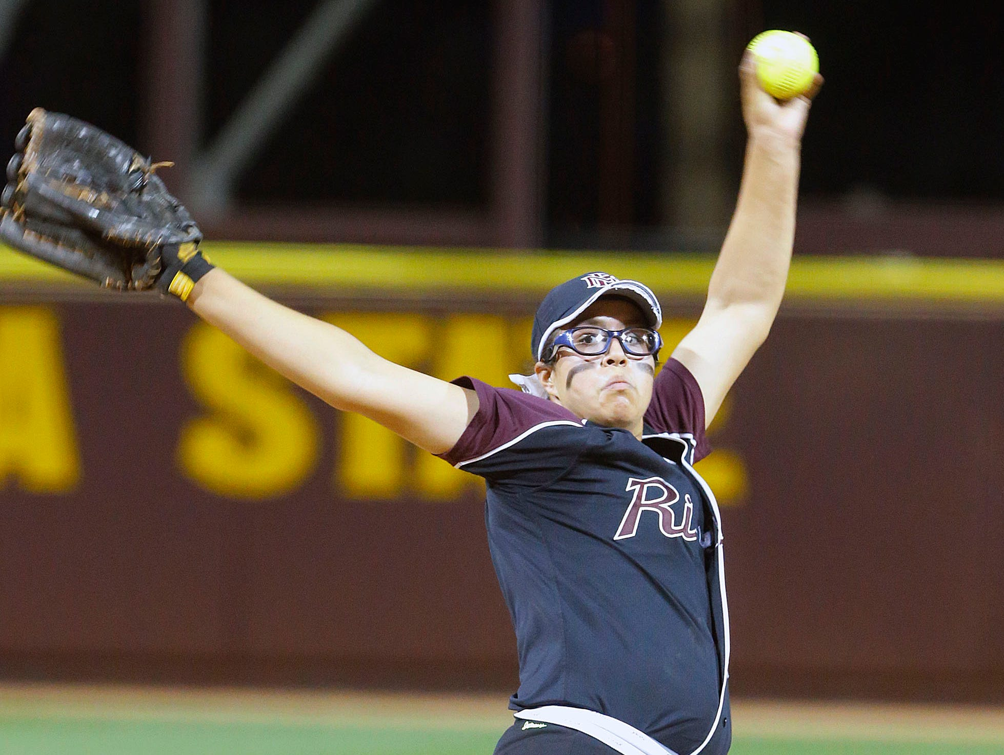Glendale Mountain Ridge pitcher Giselle Juarez throws against Red Mountain in their 8-1 loss to Mountain Ridge in the Division I state championship Monday, May 19, 2014 in Tempe.