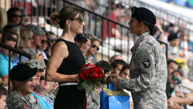 Roses are presented to Dr. Theresa Benchoff, M.D., as her husband, Col. Peter N. Benchoff, Commander, 2nd Brigade Combat Team, 101st Airborne Division (Air Assault), relinquishes his command at a ceremony Friday.
