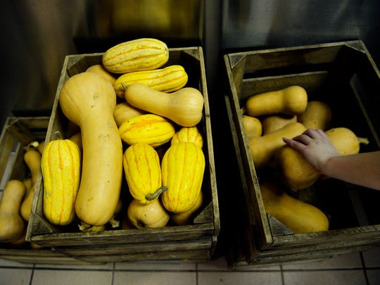 Volunteer Aliesha Rivera, 16, picks up a squash to wash during the weekend-long, second annual Squash Hunger event Friday, Jan. 15, 2016, at Farm to Freezer YORK in North York. The event, which runs through Monday, has volunteers processing 1600 pounds of donated butternut squash and other vegetables to make vegan butternut squash soup for 16 local programs including Our Daily Bread, Healthy World Cafe, the York Rescue Mission and Southern York Food Pantry.