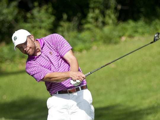 Barre's Eric Lajeunesse hits his tee shot on the eighth