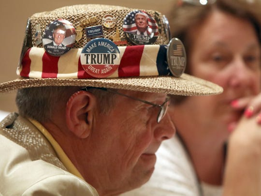 Former Assemblyman and alternate delegate Richard Kamin sports a Trump pin covered hat during the New Jersey delegation breakfast at the Doubletree Hotel in Beachwood, OH, Monday July 16, 2016.