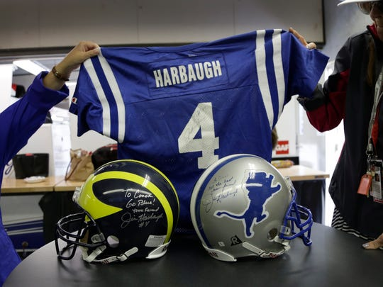 Jim Harbaugh wore No. 4 with the Indianapolis Colts. He signed a jersey to Conor Daly.