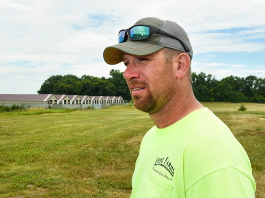 Dan Lang, Lang Fur Farms, Eden Valley, talks Tuesday, July 18, about the vandals that dismantled a fence in three spots and released about 38,000 domesticated mink. Staff and volunteers have been trying to rescue as many as they can.
