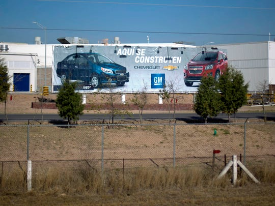 "A billboard in front of the General Motors assembly plant says in Spanish ""Built here"" featuring pictures of the Chevy Aveo and the Chevy Trax, in Villa de Reyes, outside San Luis Potosi, Mexico in January 2017. President-elect Donald Trump sent tweets in early January threatening to impose heavy tariffs on GM and Toyota cars produced in Mexico for the U.S. market."