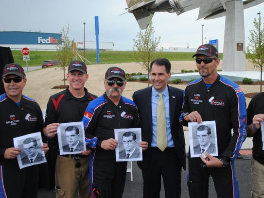 Members of the Team Fastrax parachute team pose with