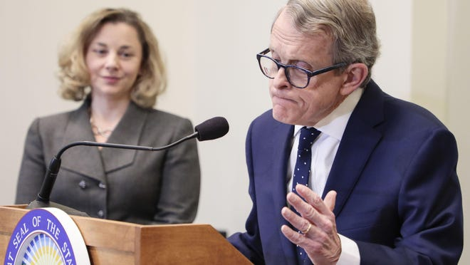 Ohio Gov. Mike DeWine unveiled his first state budget proposal amid good fiscal times in March 2019 as Kimberly Murnieks, director of the Office of Budget and Management, looks on.