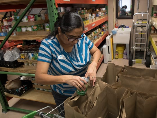 Nereida Martinez, a pantry associate at Lehigh Community Services bags donated items that will be donated to those in need. Lehigh Community Services is still serving a high number of clients that were affected by Hurricane Irma.