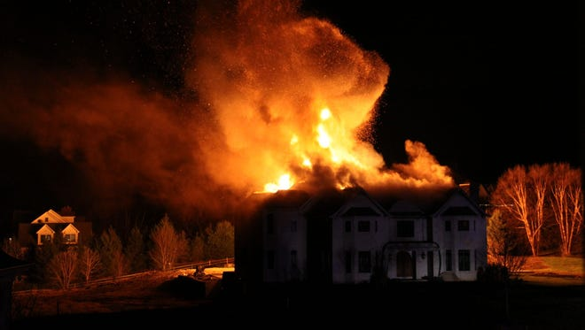 A fire ripped through a home under construction last month on Hop Brook Lane.
