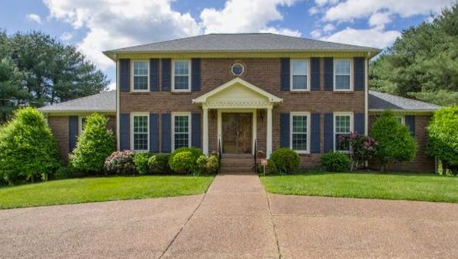 This four-bedroom Brentwood home has a recreation room/den on the main level and a large rec room in the basement with a fireplace and a half-bath.