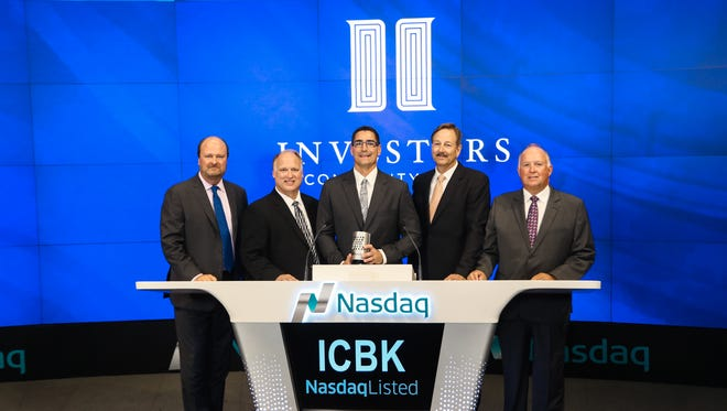 From left, Nasdaq OMX Vice President David Wicks stands with Mark Binversie, Tim Schneider, Bill Censky and Wayne Mueller, the four founders of Manitowoc-based Investors Community Bank. They rang the Nasdaq closing bell Sept. 13, 2016.