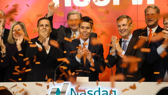 CEO Jeffery Yabuki leads the Fiserv executive team through the Opening Bell ceremonies at the Nasdaq Stock Market Wednesday