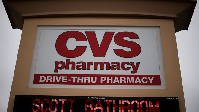 FILE - This March 17, 2014 file photo shows a CVS/Pharmacy in Dormont, Pa. CVS Health announced Tuesday, Feb. 23, 2016, is refining its prescription for controlling drug costs, and patients can expect more frequent coverage changes as the pharmacy benefits manager scours data and reacts quicker to expense spikes.