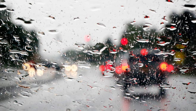 Rain pounds on the windshield of a car driving north on Clemens Center Parkway in Elmira on May 30.