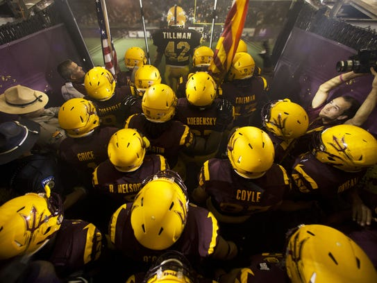 Arizona State players prepare to take the field in