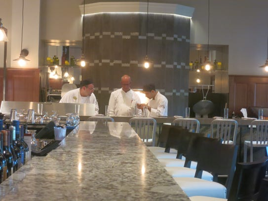 Royal Park Hotel executive chef Colin Brown, center,