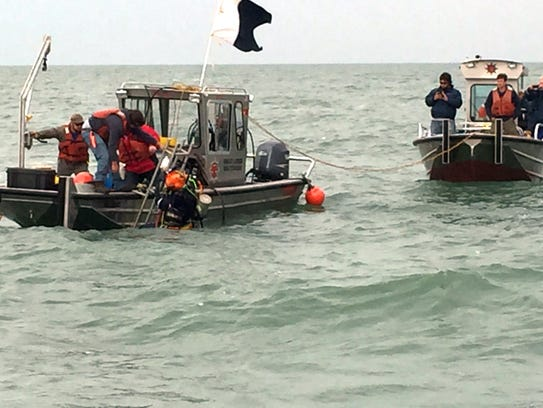 Contractors conduct dive operations at the site of