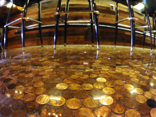 The penny floor of the new TT Bar at Tutoni's, photographed