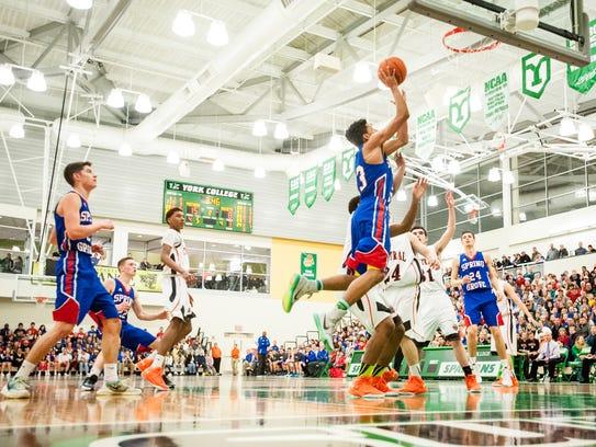 Spring Grove's Eli Brooks (23) leaps toward the basket