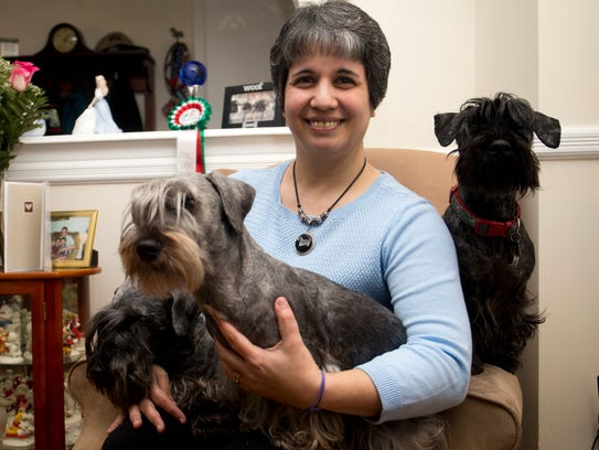 Loren Marino at home with her Cesky Terriers, Sunday,