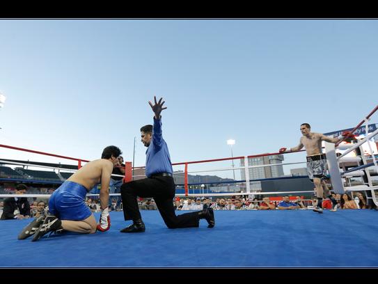 Referee Robert Velez stops the middleweight fight between