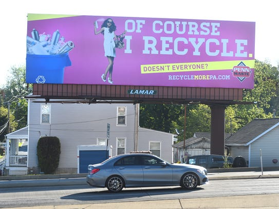 A billboard advertises Penn Waste, which serves more