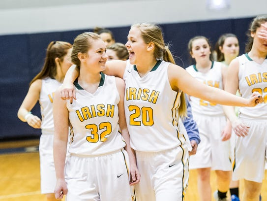 York Catholic's Amelia Strayer (32) and Kiersten Reed