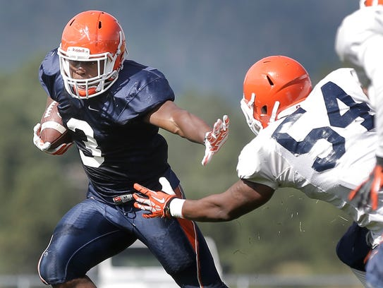 UTEP running back Treyvon Hughes looks to get outside