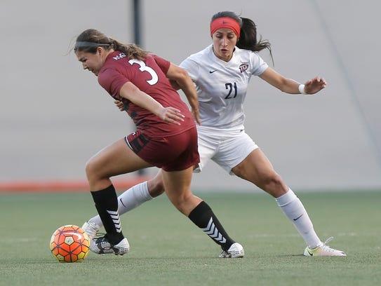 UTEP midfielder Bri Barreiro defends NMSU's Audrey