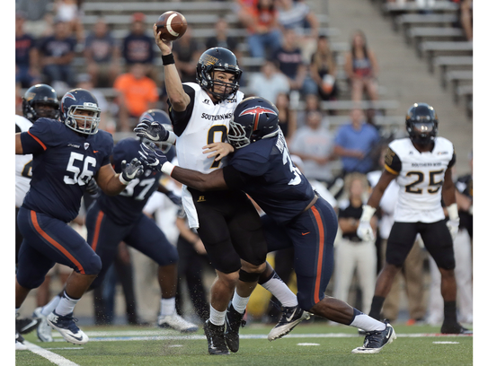 Southern Miss quarterback Nick Mullens is hit by UTEP
