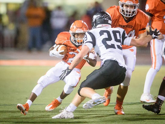 Central York's Noreaga Goff (2) looks for yardage against
