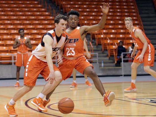 UTEP walk-on guard Hudson Urbanus is defended by fellow