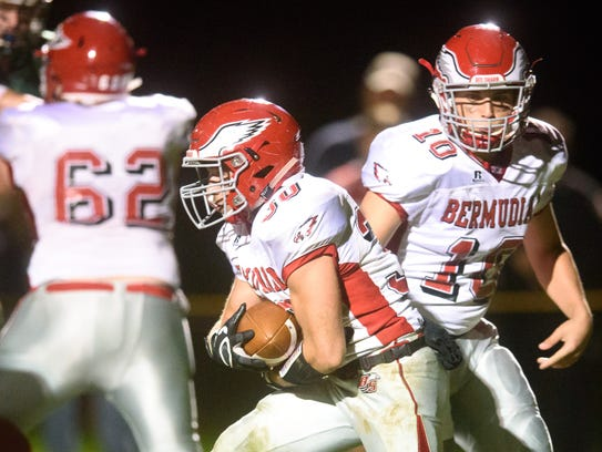 Bermudian Springs fullback Ashton West (30) takes a