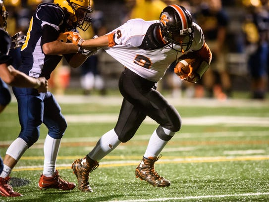 Eastern York's Kaleb Corwell (33) drags down York Suburban's