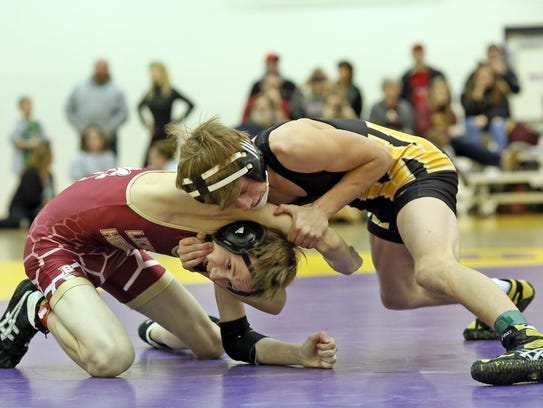 Watkins Memorial senior Alec Fulwider wrestles Licking Heights' Mitchell Coultas during this past season's East Side Duals. Fulwider has placed fifth in the Division I district tournament each of the past two seasons.